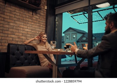 Proposal and anniversary. Business meeting of man and woman. Couple in love at the restaurant. Date of family couple in romantic relations, love. Valentines day with sexy woman and bearded man.