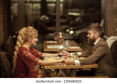 Proposal and anniversary. Valentines day with sexy woman and bearded man. Business meeting of man and woman. Date of family couple in romantic relations, love. Couple in love at the restaurant