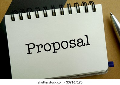 Proposal memo written on a notebook with pen