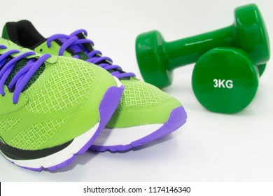 Propositos September and December. Go to the gym. sport sneakers and dumbbells on white background. Do sport. Healthy lifestyle. Lose weight. horizontal and vertical pictures. Different colors of spor