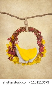 props for photographing newborns, pendant ring on a branch with yellow and red leaves on a beige background, yellow skin, digital