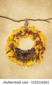 props for photographing newborns, pendant ring on a branch with acorns, yellow and red leaves and a brown skin on a beige background