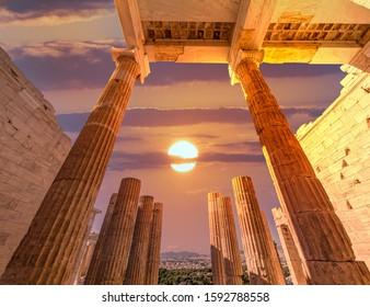 """Propylaea"" the entrance of Acropolis illuminated by dramatic fiery sunny sky, Athens Greece"