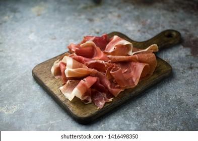 Prosciutto di Parma on cutting board