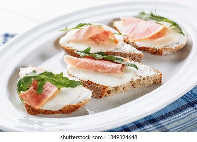 Prosciutto Mozzarella Italian Bread Sandwich Food Side View. Sliced Jamon Meat on Cheese with Arugula Snack for Traditional Lunch Catering Serving. Delicatessen Breakfast Baguette Appetizer Hamon