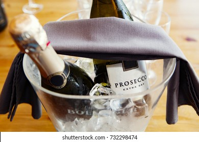 Prosecco bottles, over ice in an ice bucket