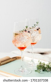 Prosecco cocktail, an aperitif with Prosecco, a white sparkling italian wine, bitter, thyme and juniper berries