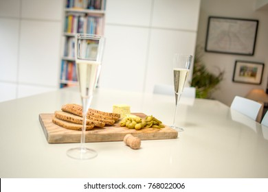 Prosecco Glass in Kitchen with Cheese and Bread