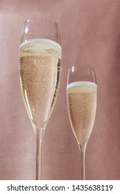 Prosecco, an italian sparkling wine, in flutes, on a elegant pink background