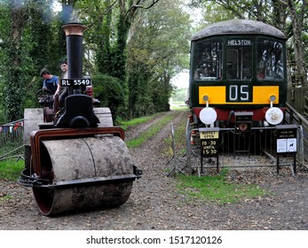 Prospidnick, Cornwall / UK - 09/15/2019: 1927 Charles Burrell & Sons Class A steamroller (l) and static 1955 British Rail Class 103 diesel multiple unit currently used as a café at the Helston Railway