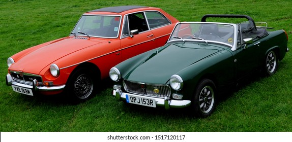 Prospidnick, Cornwall / UK - 09/15/2019: 1973 MG B GT V8 (l) and 1976 MG Midget 1500 (r) at the Helston Railway's 2019 Heritage Transport Weekend.