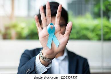 Prostate Cancer Awareness month, Business Man holding light Blue Ribbon for supporting people living and illness. Men Healthcare and World cancer day concept