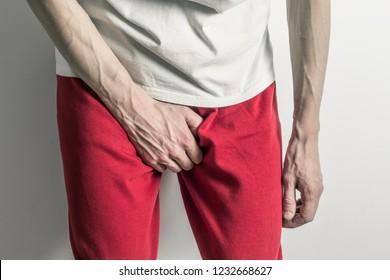 Prostate concept, inflammation of the bladder. Premature ejaculation. Man holding penis.