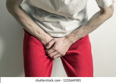 Prostate. A man clings to a sore penis. Bladder cancer. Premature ejaculation.