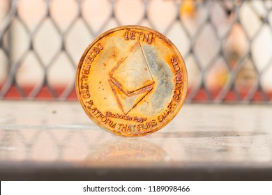Prostejov Czech Rep. 16th September 2018 Rusty and dirty Ethereum coin standing on a dusty glass. No longer atractive coin..
