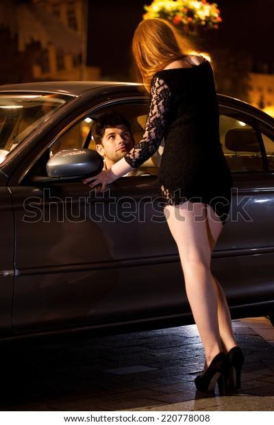 prostitute-her-client-car-vertical-600w-