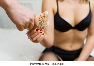 Prostitute takes money for her work.