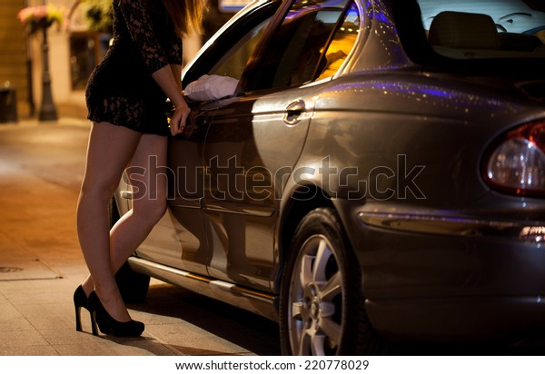Prostitute talking with client on the street