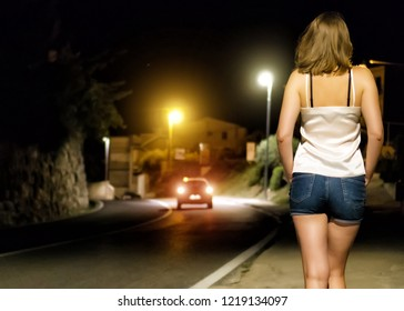 Prostitute waiting for the client at night street.
