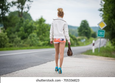 Prostitute waiting for clients near a road