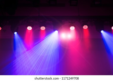 The protagonist on the stage of the theater, the spotlight designed by the lighting engineer, the projection lamp