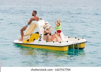 PROTARAS, CYPRUS - JUNE 4, 2019: People on catamaran enjoying their journey to the Mediterranean sea
