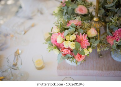 Protea and pink green roses for wedding centerpiece