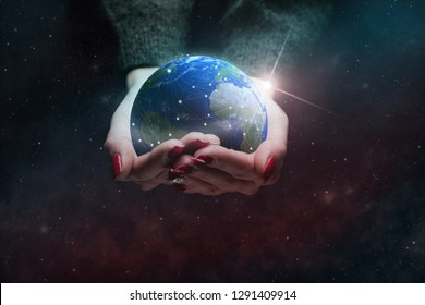 Protect our world in woman hands and nebula dust. Mixed media .Elements of this image furnished by NASA.