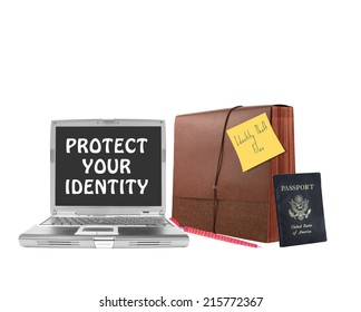 Protect Your Identity on laptop screen next to file folder pen and US passport isolated on white background
