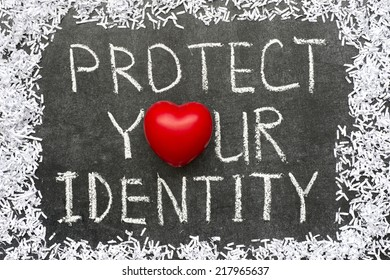 protect your identity phrase handwritten on blackboard with heart symbol instead of O