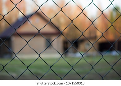 protected house behind fence