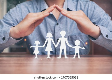 Protecting hands over paper family, family Protection and stay home or working at home with care concept