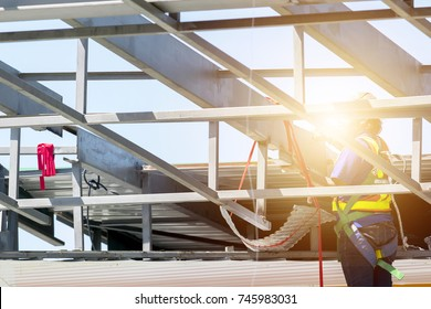 Protecting yourself is very important, High risk work it can be easily encountered, construction worker put on protective equipment act on the scaffolding.
