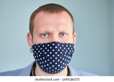 Protection against contagious covid-19 disease. Portrait of man wearing black mask at grey background. Coronavirus concept, sick.