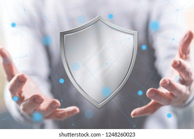 Protection concept above the hands of a man in background