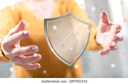 Protection concept between hands of a woman in background
