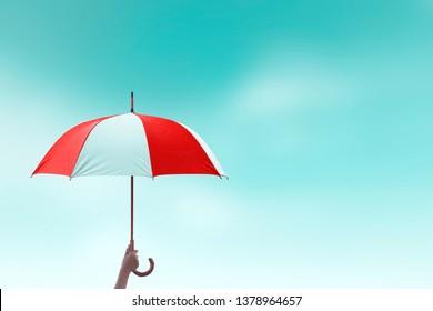 Protection concept: hand holding rainbow umbrella distinctively unique