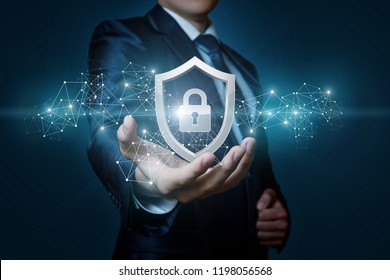 Protection network security computer in the hands of a businessman on a blue background.