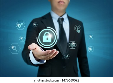 Protection network security computer and safe your data concept, Businessman holding shield protect icon