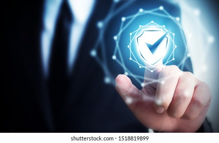 Protection network security computer and safe your data concept, Businessman touching shield protect icon