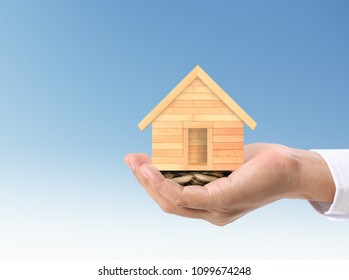 protection or in salesman person giving to buyer customer,house in hand