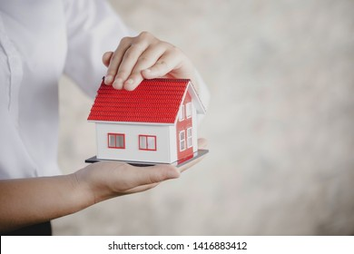 protection or in salesman person giving to buyer customer, house in hand