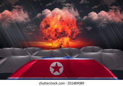 Protection Umbrella with flag of North Korea on a war background