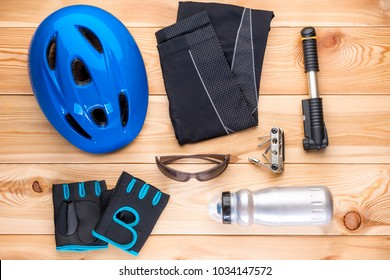 Protective accessories for cycling and tools on the wooden floor
