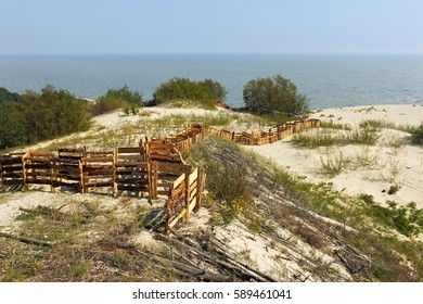 Protective barriers in the dunes of the Curonian Spit National Park. The spit is a 98 km long curved sand-dune spit that separates the Curonian Lagoon from the Baltic Sea. UNESCO World Heritage Site.
