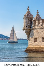Protective corner turret on the Tower of Belem (Torre de Belem), the river Tejo (Tagus) with whitw sial in the background - Lisbon, Portugal