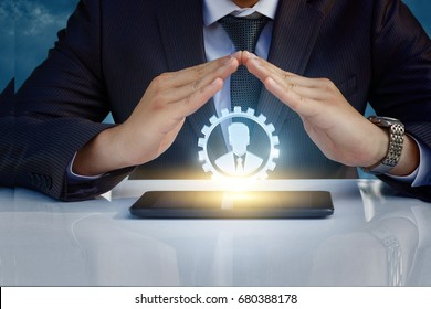 The protective gesture with your hands good worker. Human capital.
