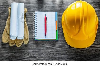 Protective gloves construction plans safety cap notebook pen.