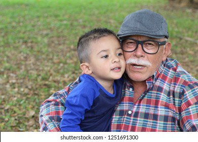 Protective grandfather with baby grandson