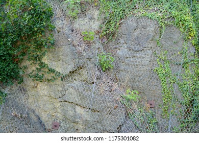 Protective grid on the mountainside